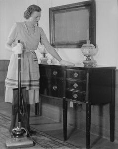 Woman dusting and using a vacuum
